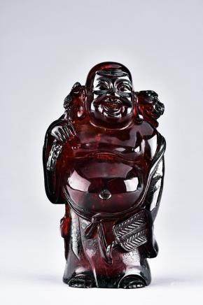 AN AMBER CARVED LUOHAN