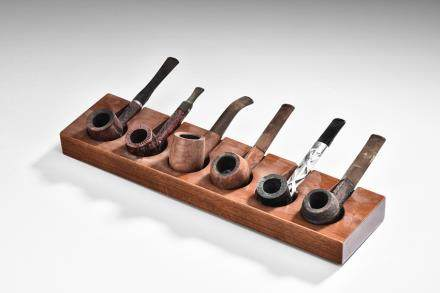 A GROUP OF SIX SMOKING PIPES