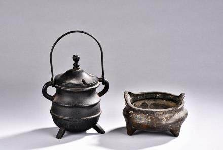 A SET OF TWO BRONZE CENSERS