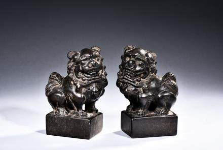 A PAIR OF STONE CARVED LION PAPER WEIGHTS