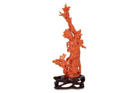 A CHINESE CORAL CARVING OF MAGU.