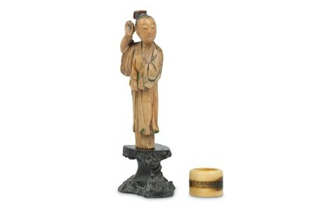 A SMALL CHINESE STAINED SOAPSTONE FIGURE TOGETHER WITH A DEER BONE ARCHER'S RING.