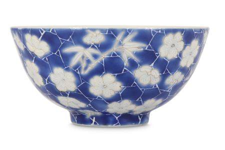 A SMALL CHINESE BLUE-GROUND 'PRUNUS AND BAMBOO' CUP.