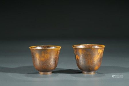 A PAIR OF YELLOW AND RUSSET GLAZED CUPS