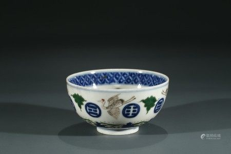 A CHINESE FAMILLE ROSE AND BLUE BOWL