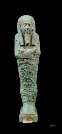 Bel et fin oushebti inscrit dont d'un cartouche. Fritte turquoise cassée collée. [...]