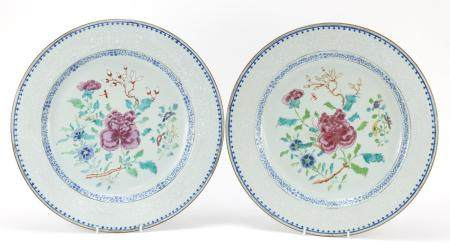 Good pair of Chinese porcelain chargers, each finely hand painted in the famille rose palette with