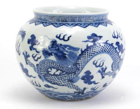 Chinese blue and white porcelain jar, hand painted with two dragons amongst clouds within ruyi