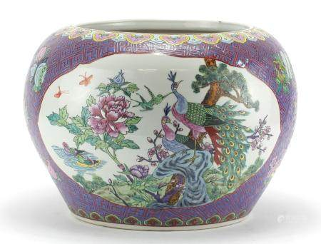 Large Chinese porcelain fish bowl, finely hand painted in the Famille Rose palette with panels of