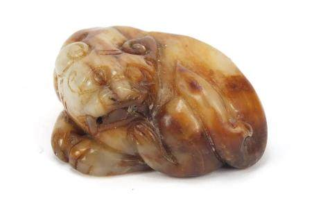 Chinese white and russet jade carving of a lion :For Further Condition Reports Please Visit Our