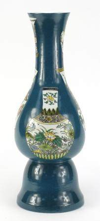 Chinese porcelain vase, hand painted with vases on to a green ground, six figure character marks