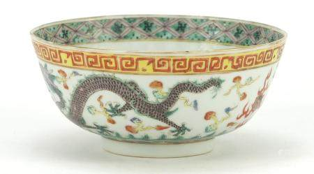 Chinese porcelain bowl, hand painted in the famille vert palette with dragons chasing flaming