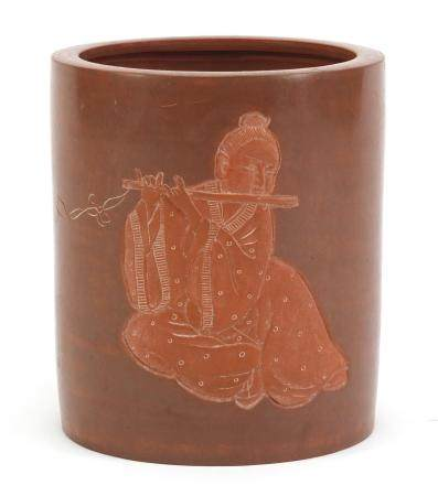 Chinese Yixing terracotta brush pot, incised with a figure playing a flute, impressed character