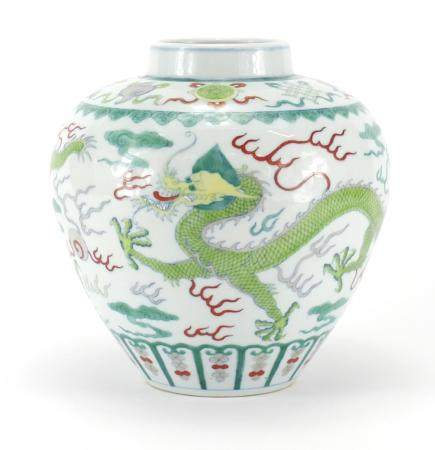 Chinese porcelain Wucai vase, hand painted with two dragons chasing the flaming pearl amongst clouds