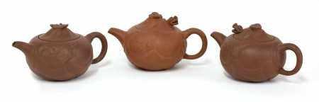 A collection of three Yixing zisha teapots,