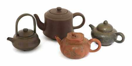 A collection of four Chinese Yixing zisha teapots,