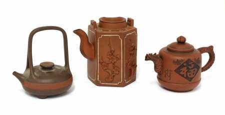 A collection of three Chinese Yixing zisha teapots,