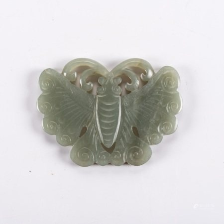 A CHINESE CELADON JADE BUTTERFLY PENDANT, LATE 19TH/EARLY 20TH CENTURY The segmented wings carved