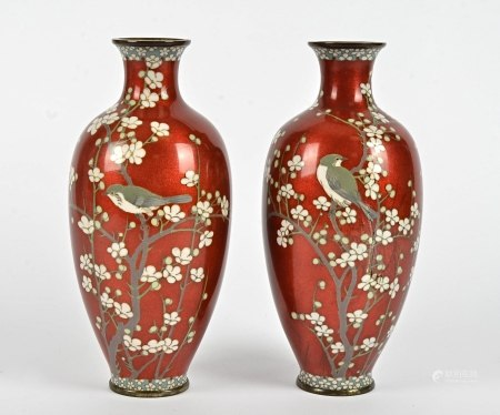 A pair of Japanese cloisonné vases, red ground decorated with birds on floral branches, height 24cm,