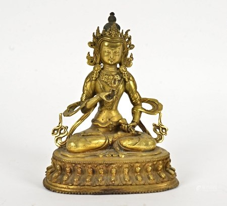A late 19th Century metalwork Tibetan Buddha, seated in the lotus position, height 21cm