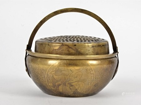 A 20th Century Chinese brass censor, decorated with character marks and symbols, two handles, seal