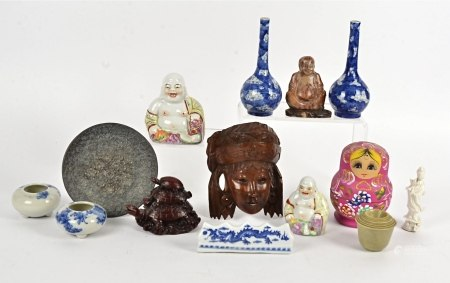An assortment of Asian works of art, including a pair of overglaze polychrome laughing Buddhas,