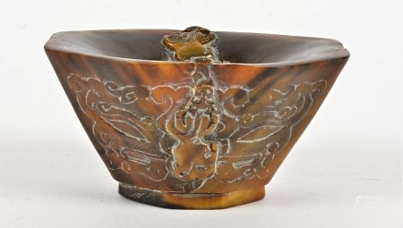 A 19th Century Chinese rhinoceros horn libation cup, the design comprising four mythical beasts