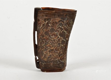 A Chinese horn libation cup, each side with multiple mythical beasts, probably mid 20th Century