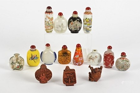 A quantity of Chinese snuff bottles, to include cinnabar lacquer examples, cameo glass, a wooden