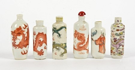 A small quantity of Chinese snuff bottles, in polychrome enamels, predominantly with dragons chasing