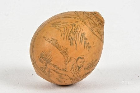 A Chinese gourd with profusely carved decoration, showing a pair of figures in a mountainous