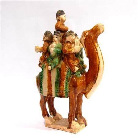 A Tall Tri Glazed Bactrian Camel, a Molded Saddle Cloth & Fi