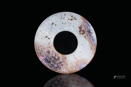 青玉沁色捲雲紋環