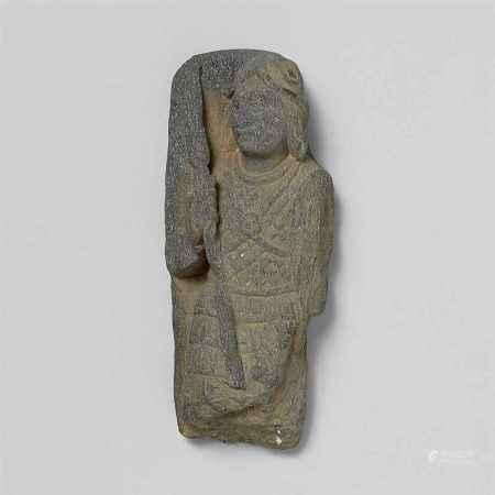 A Gandhara gray schist architectural fragment of a warrior. Pakistan. 2nd/3rd century