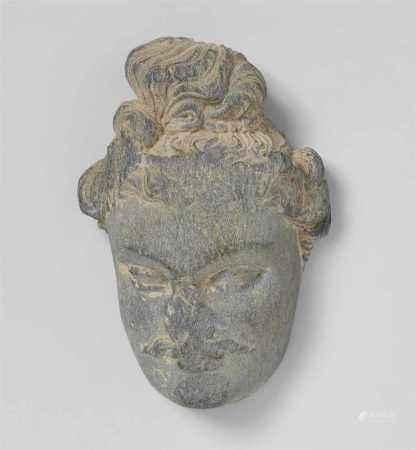 A Gandhara gray schist head of a bodhisattva. Pakistan. 2nd/3rd century