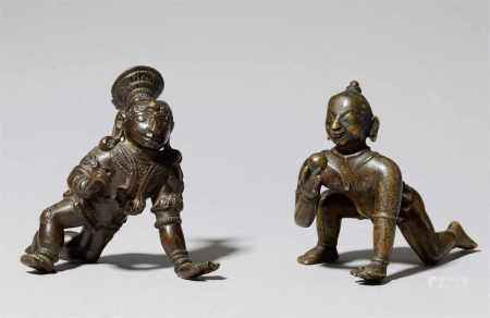 Two Indian copper alloy figures of a crawling Bala Krishna. 19th century