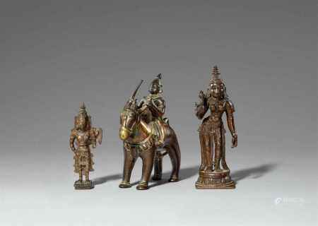 Three copper alloy figures. 20th century
