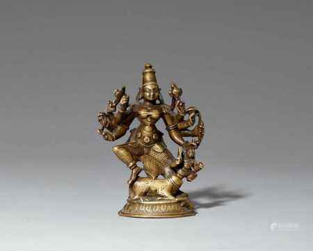 A Central Indian brass figure of an eight-armed Durga. 19th century
