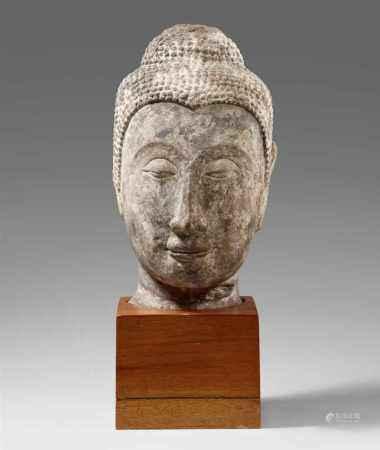 An Ayutthaya sandstone head of a Buddha. Thailand. 15th/16th century