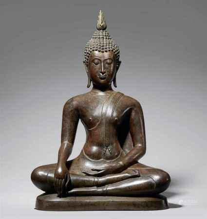 A large Sukhothai style bronze figure of Buddha Shakyamuni. Thailand. 17th/18th century