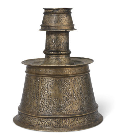 A SILVER-INLAID BRASS CANDLESTICK