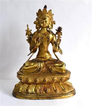 A Sino-Tibetan Gilt Bronze Alloy of a Green Tara, Impressed