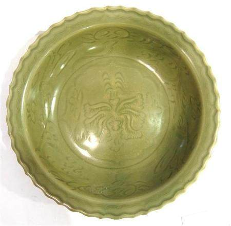 A Large Chinese Celadon Glazed Dish Incised with Floral Patt