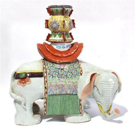 A Large Chinese White Porcelain Elephant with an Archaic Bro