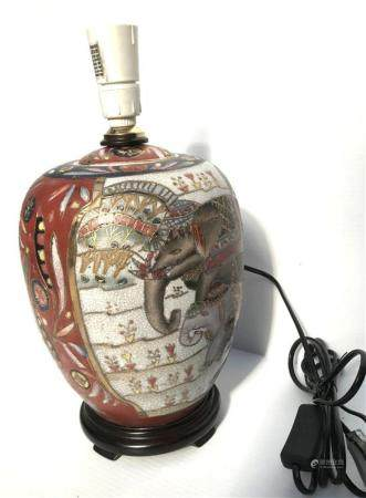 Two Ovoid Shaped Lamp Bases with an Elephants on the Front &