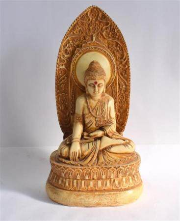 A Carved Composition Buddha Seated in Front of a Flame Shape