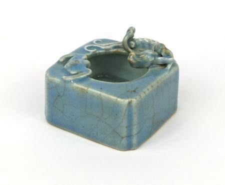 Chinese porcelain robin egg glazed brush washer, decorated in relief with a bat and water dragon,