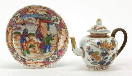 Chinese porcelain teapot and a saucer hand painted in the Mandarin palette with figures, the largest