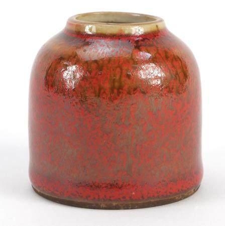 Chinese porcelain brush washer having a mottled red glaze, blue ring marks to the base, 6.5cm