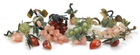 Collection of Chinese jade, agate and hardstone fruit including grapes, apple and peaches, the